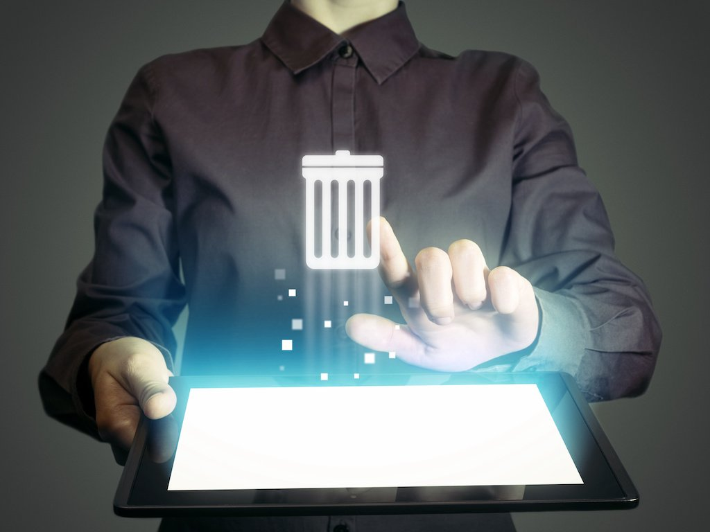 Person pressing a floating trash can icon