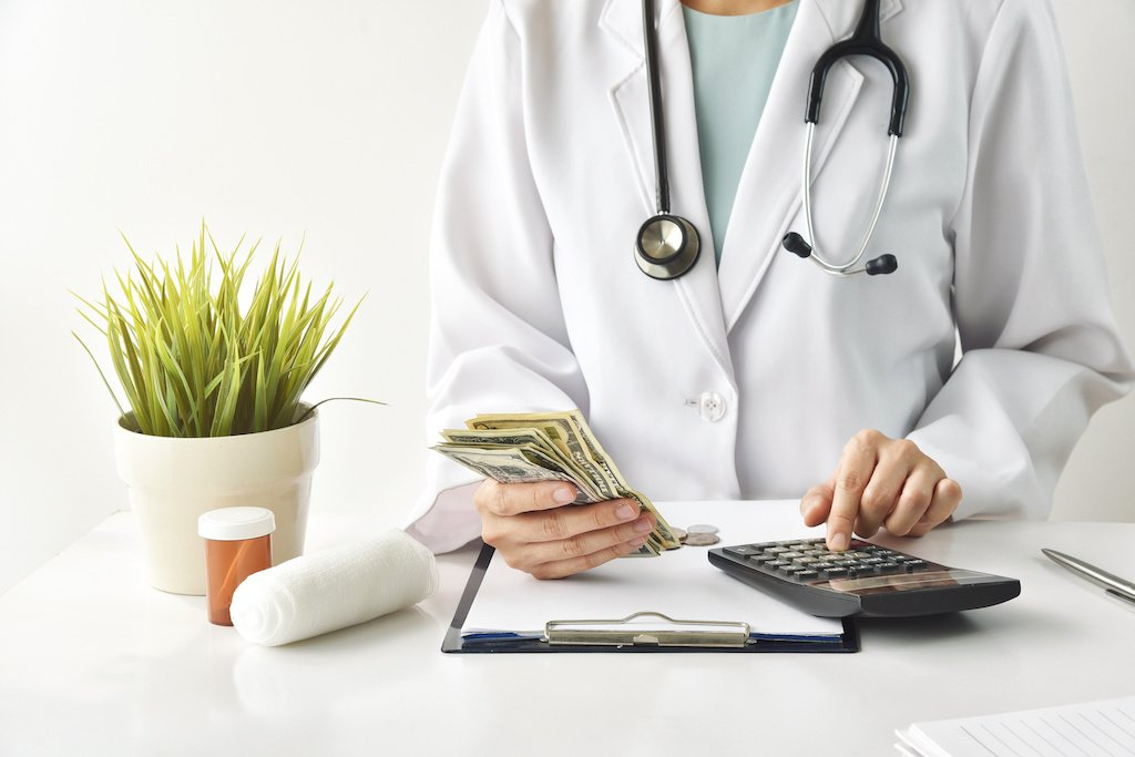 doctor with money and calculator