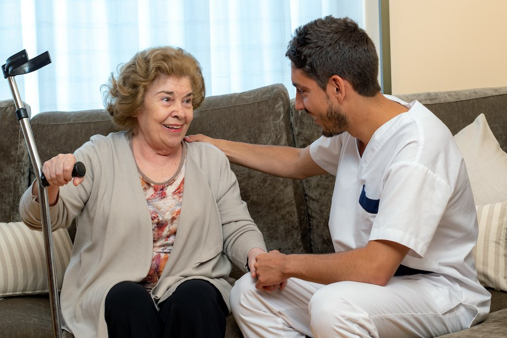 Physicians asistant with patient at home