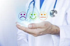 doctor with smiley emojies for satisfaction